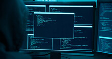 Asian Male Hacker Use Laptop