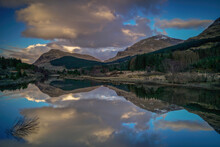 River Lochy With Reflections And Mountain Background. Located In Thhighlands, Scotland