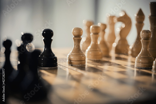 Wooden chess pieces on the chessboard. Fototapete