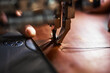 canvas print picture - Working process of leather craftsman. Tanner or skinner sews leather on a special sewing machine, close up.worker sewing on the sewing machine