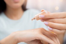 Macro Photo Beauty Master Young Woman Chooses Foundation For Skin Of Face, Selects Tone Of Cream On Her Hand