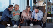 Family Company. Three Family Relatives Supporting Middle Aged Greyhaired Man Playing Mobile Game On Smartphone Rejoicing In The House. Apartment. Weekend.