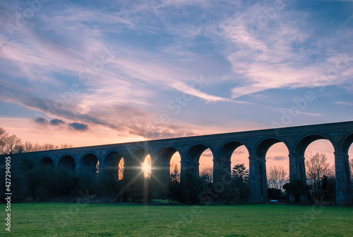 Stampa su Tela Sunset over the Chappel Viaduct in Essex, UK