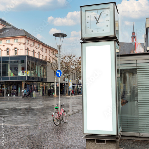 Fototapeta Blank billboard with space for text on a boulevard in the center of the German t