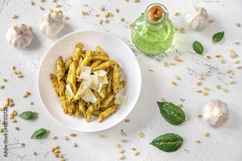 Fototapeta Portion of penne pasta with pesto sauce