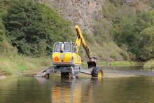 Walking Dredger Working In The River - River Bed Restoration