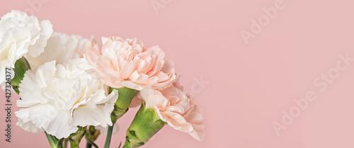 Fotografie, Obraz Spring flower bouquet of carnations over pink background