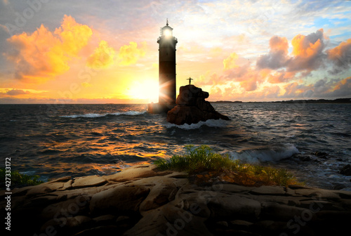 Lighthouse keeper on lighthouse with beacon at sunset evening - seascape Fototapete