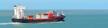 Large Container Ship Sailing From The Port Of Antwerp. Vlissingen, The Netherlands. Freight Transportation, Nautical Vessel, Logistics, Industry, Commerce, Environment. Panoramic View, Copy Space