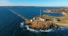 Aerial View Of Eastern Point Lighthouse And Gloucester Harbor, Cape Ann, Northeastern Massachusetts MA, USA. This Historic Lighthouse Was Built In 1832 On The Gloucester Harbor Entrance.