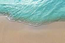 Summer With Turquoise Wave In Tropical Beach. Soft Waves With Foam Of Blue Ocean On The Sandy Beach.