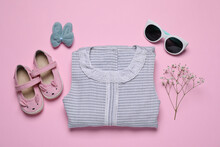 Flat Lay Composition With Stylish Child Clothes And Accessories On Pink Background