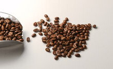 Pile Of Dark Roasted Coffee Beans On White Background