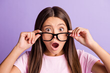Photo Of Young Preteen Girl Amazed Shocked Surprised Fake Novelty News Hands Touch Glasses Isolated Over Violet Color Background