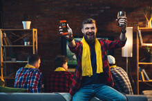 Group Of Friends Watching TV, Sport Match Together. Emotional Man Cheering For Favourite Team, Celebrating Successful Betting. Concept Of Friendship, Leisure Activity, Emotions