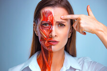 Young Woman With Half Of Face With Muscles Structure Under Skin. Model For Medical Training On A Light Background. Close Up Video Of Face Human Anantomy.
