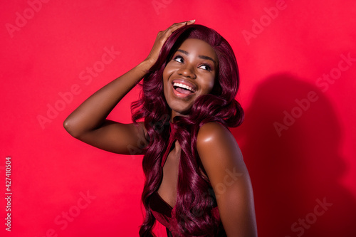 Fototapeta Photo of attractive nice afro american young woman look empty space hold hand em