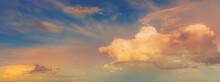 Beautiful Evening Cumulus Clouds Golden With Pink Blue Sky