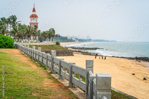 Fototapeta Haikou beachside panorama with the Guanhaitai clock tower Haikou Hainan China