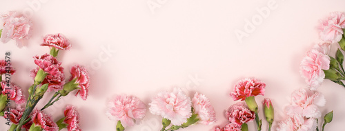 Design concept of Mother's day holiday greeting with carnation bouquet on pink table background - fototapety na wymiar