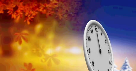 A clock face standing against a background of autumn leaves and winter landscape