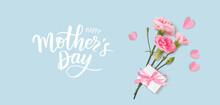 Happy Mothers Day. Calligraphic Greeting Text. Holiday Design Template With Realistic Pink Carnation Flowers, Gift Box And Paper Hearts On Blue Background. Vector Stock Illustration.