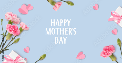 Fototapeta Happy Mothers day. Holiday design template with realistic pink carnation flowers, gift box and paper hearts on blue background. Spring banner. Vector stock illustration. obraz