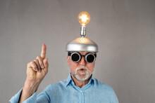 Senior Businessman Have A Bright Idea