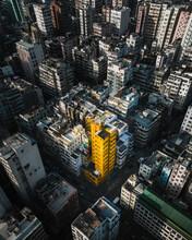 Hong Kong - 14 February 2019: Aerial View Of Urban Grid On Kowloon And Yellow Tower At Sunset, Hong Kong