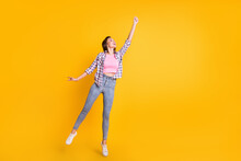 Full Length Body Size View Of Attractive Skinny Cheery Girl Jumping Holding Invisible Parasol Isolated Over Bright Yellow Color Background
