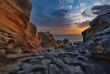 Russia. Dagestan. Dawn On The Rocky Shore Of The Caspian Sea Near The City Embankment Of Makhachkala.