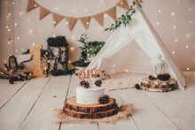 Stylish Light Photo Zone With A Cake, One Topper And A Children's Hut