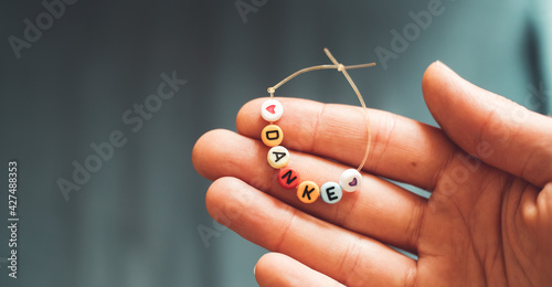 "Canvas-taulu Thank you concept: Close up of bracelet with the german letters ""Danke"""