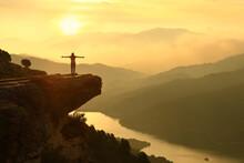 Woman Celebrating In A Beautiful Sunset Landscape