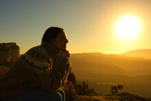 Woman Silhouette Meditating At Sunset In The Mountain