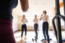 Teen Girls Learning Boxing Fighting Stance In Gym Studio