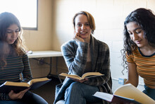 Portrait Happy Teen Girl Reading In Book Club Meeting