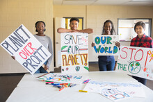 Portrait Teen Activists With Environmental Posters In Community Center