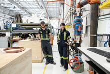 Technicians In Workshop In Helicopter Hangar