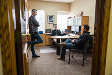 Three Men Having Meeting In Office