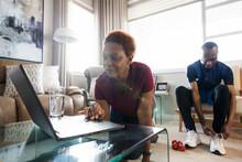 Senior Couple Preparing To Exercise At Home