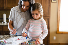 Mother And Daughter Painting At Home