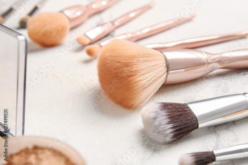 Fototapeta Stylish makeup brushes on light background obraz na płótnie
