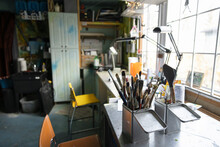 Boxes Of Paintbrushes On Studio Worktop