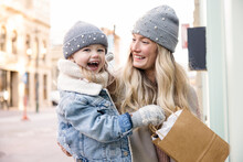Portrait Happy Carefree Blonde Mother And Daughter Shopping In City