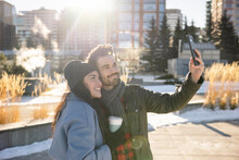 Happy Young Couple Taking Selfie In Sunny City Winter Park