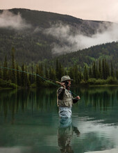 Man Fly Fishing In Pond