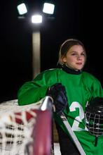 Portrait Of Hockey Goalie Leaning On Goal Post