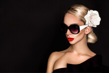 Sunglasses Fashion. Portrait Of Beautiful Elegant Woman In Fashionable Sunglasses With Perfect Makeup And Red Lips And Nails On Black Background In Studio. Elegance.