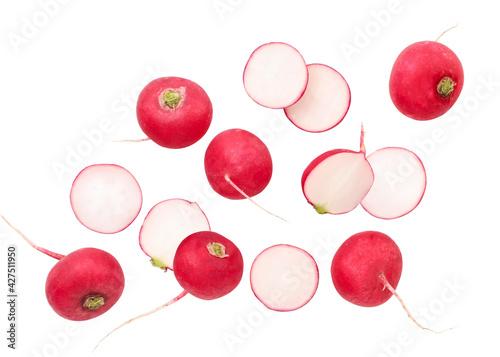 Fresh whole radish and pieces are flying on a white background, radish levitating. Isolated